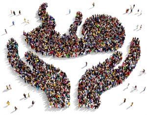 shape of hands holding a baby made up of a crowd of people